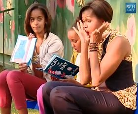 Michelle Obama reading aloud with her kids