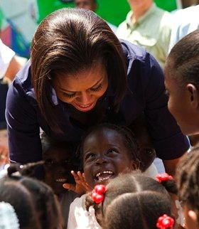 Michelle Obama with child in Haiti - WH Photo