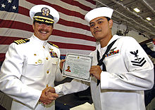 Navy machinist receives citizenship certificate aboard Navy ship
