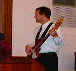 family photo of bass playing son