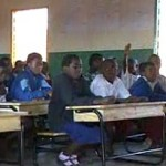 Malawi classroom desks seat 3 kids each -MSNBC video