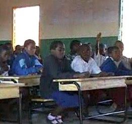 Malawi classroom desks seat 3 kids each -MSNBC video