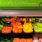 "Fresh produce on shelf, ""Locally Grown"""