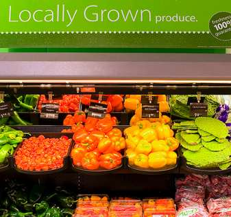 "Fresh produce on shelf, ""Locally Grown"""
