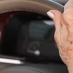 elderly hands on the steering wheel