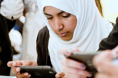 Apps For Good photo of Muslim girl with mobile phone