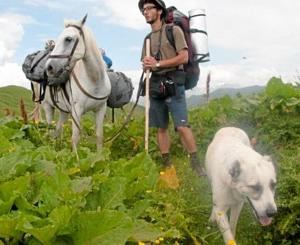 Herder dog adopts mountain hikers, familyphoto