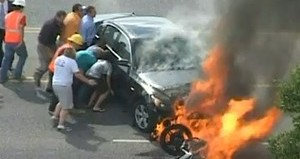 Motorcyclist under burning car - YouTube video