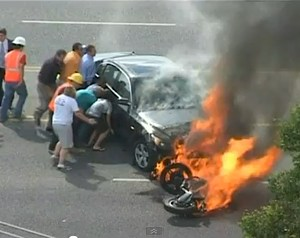 eyewitness video shows bystanders lifting car on fire