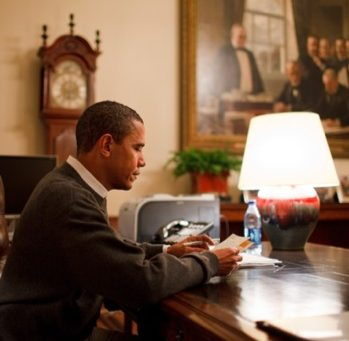 Obama reads letters at desk WH photo