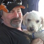Trucker with dog - photo from Operation Roger