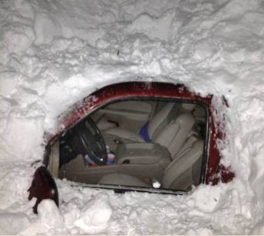 snow entombed car in New Mexico