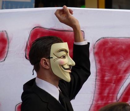 Occupy Wall Street mask in Paris demonstration by stanjourdan-cc