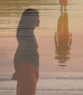 woman-reflection-water-sad-cnnvid