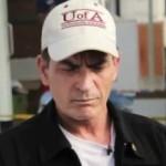 Charlie Sheen in Alabama hat, during tornado visit