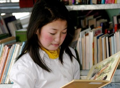 Child reading in Mongolia -Bookbridge photo