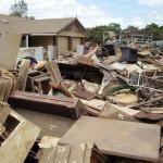 flood-debris-outside-brisbane-home-davidbuschaus