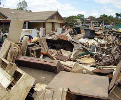 debris from disaster piled in neighborhood-photo by davidbuschaus