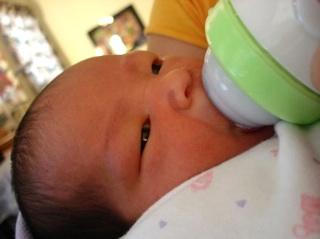 bottle-feeding baby, photo by Kahanaboy via Morguefile