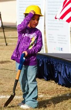 child at groundbreaking for Green Schoolhouse