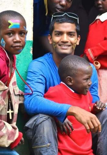 African kids with Kyle De Souza - Curtin.edu photo