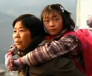 Chinese grandmother carries girl to school every day in China
