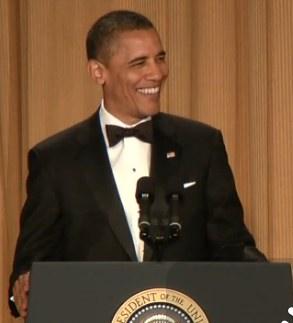 Obama laughs podium