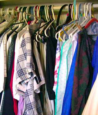 closet of clothes by sideshowmom via Morguefile