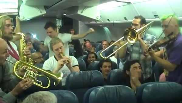 Lemon Bucket Orkestra plays on airliner