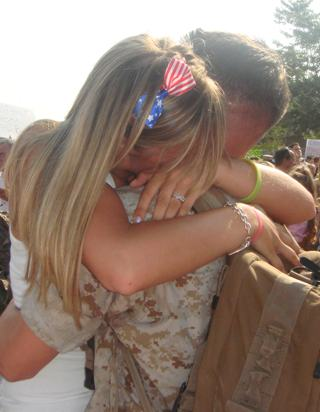 Soldier welcomed home by daughter - family photo by Brittany Rood