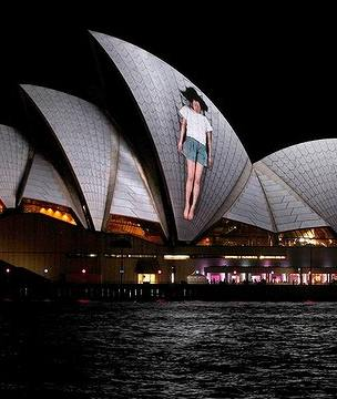 Sydney Opera House with a projected woman on front