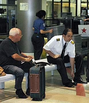 TSA screening, photo by SS&SS via Flickr-CC