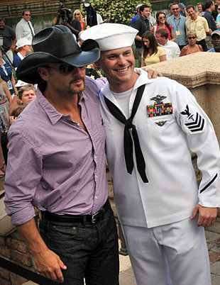 Tim McGraw with sailor on Military Appreciation Day