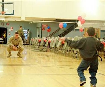 boy walks into soldiers arms