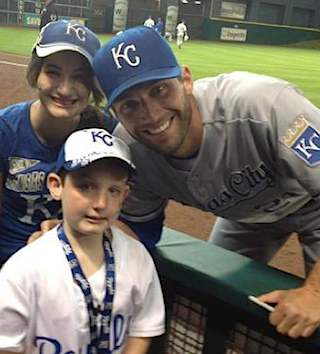 Baseball MLB player Jeff Francoeur poses with autism fan