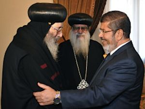 Egyptian Islamist president welcomes Coptic leader -govt photo release
