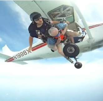 skydiving birds eye view with 90-yo man