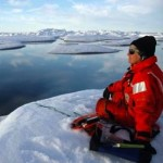 Sue Moore listens for bowhead whales - NOAA photo