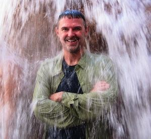 Darin  Hollingsworth under waterfall