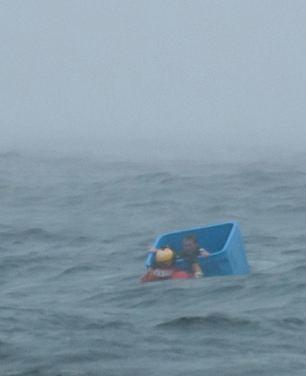 Ocean survivor floats in crate-Joel Brady-Power