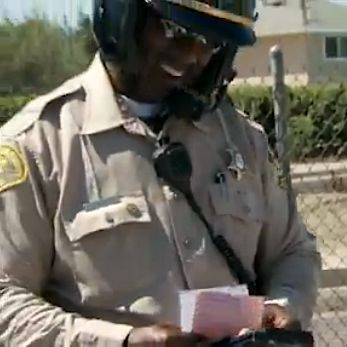 smiling traffic deputy -CBS video
