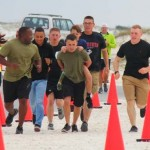 racing marines carry boy w Prosthetic