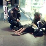 Cop and homeless shoeless man-JenniferFoster
