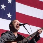 Dave Matthews in front of flag, VA