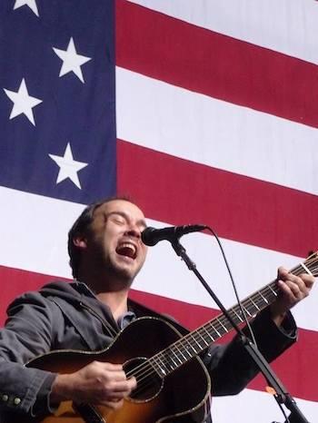 Dave Matthews in front of flag, VA