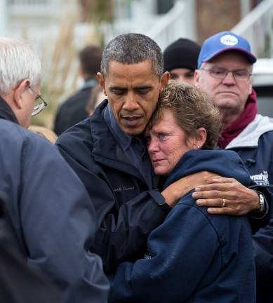 Obama comforts NJ Marina owner WH photo