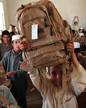 Afghan kids get backpack donations -NATO photo