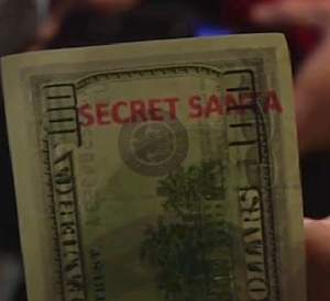 100 Dollar bill w/ Secret Santa stamp