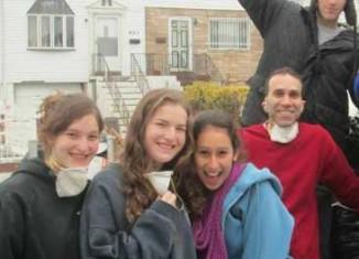 Israeli teens sop up Sandy damage -FB photo