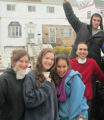 Israeli teens sop up Sandy damage -FB photo